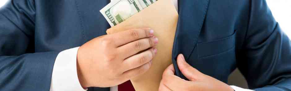 Aberdeen Advisors M&A: Closeup conceptual photo of a bribed man putting money in the suit pocket