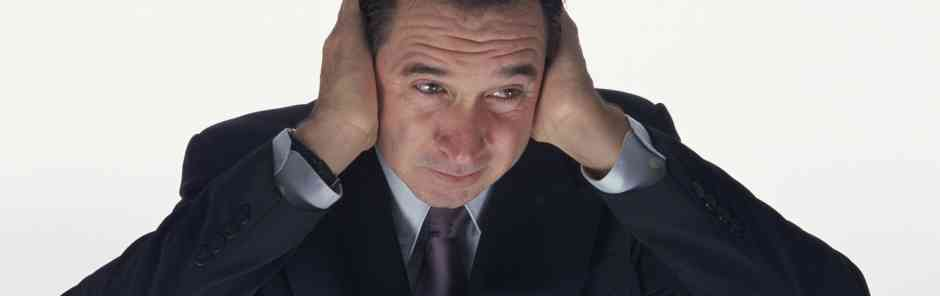 Aberdeen Advisors M&A: Businessman covering his ears with his hands